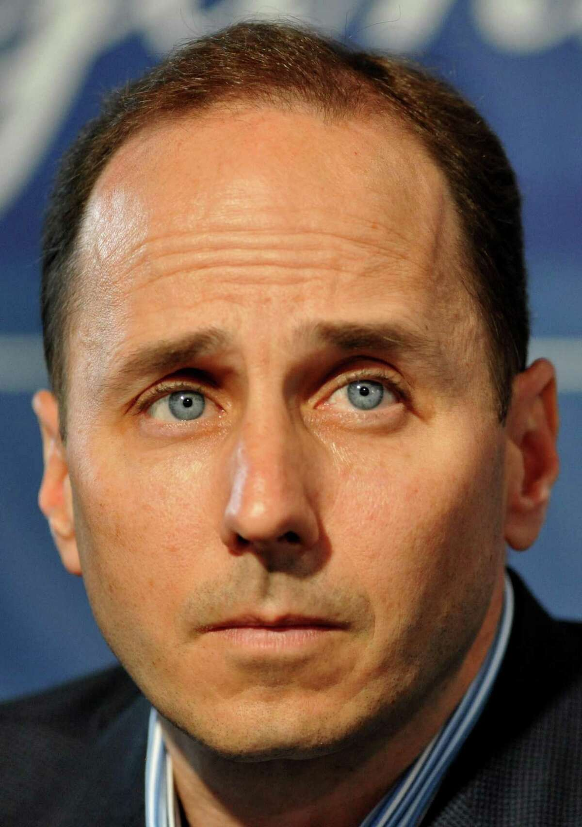 New York Yankees General Manager Brian Cashman, who lives in Darien, is slated to accompany Santa Claus on a 22-floor rappel down the Landmark Building in Stamford, Conn., Sunday.
