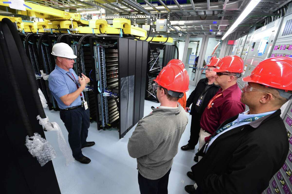 Visitors tour the Summit supercomputer at Oak Ridge National Lab as it nears completion.