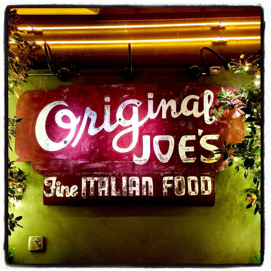 The Taylor Street sign that survived a 2007 fire now hangs at Original Joe's restaurant in North Beach Nov. 17, 2017. Photo: Catherine Bigelow, Special To The Chronicle