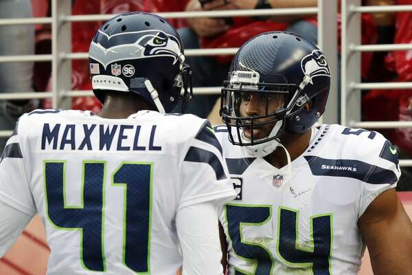 Seattle Seahawks middle linebacker Bobby Wagner (54) celebrates after intercepting a pass with teammate Byron Maxwell (41) during the first half of an NFL football game against the San Francisco 49ers Sunday, Nov. 26, 2017, in Santa Clara, Calif. (AP Photo/John Hefti)