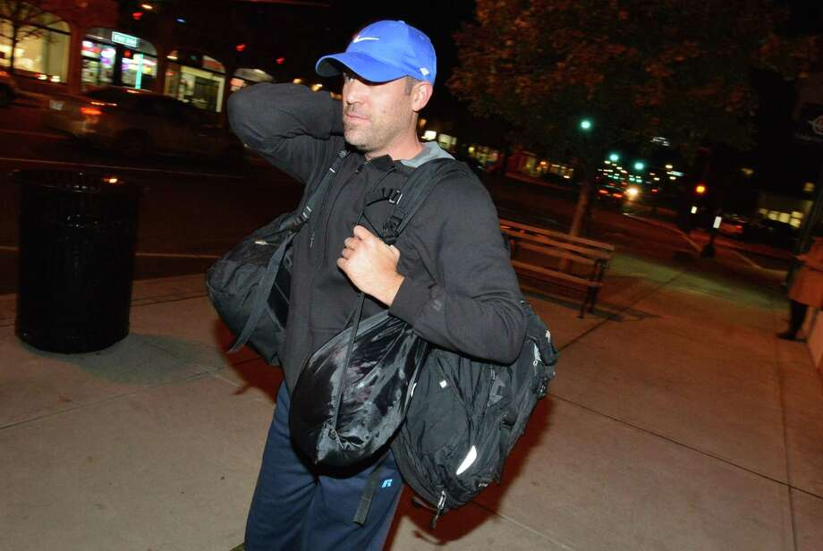 New Canaan's Jay Dailey has two backpacks and 7 turkeys but after one backpack broke he passed two birds off and ran with 5 along with a the group of runners from Endurance House on West Ave. They group ran and delivered more than two dozen turkeys and holiday food to donate to the Open Door Shelter, 1.5 miles away in Norwalk Conn. on Tuesday November 14, 2017 Photo: Alex Von Kleydorff / Hearst Connecticut Media / Norwalk Hour
