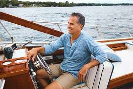 Shot of a mature man enjoying a relaxing boat ride