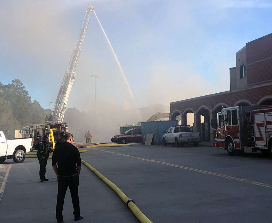 First responders put out a small fire behind Kingwood High School on Monday, Nov. 27. Insulation caught fire while a water tank was being disassembled. The building was not impacted. Photo: Courtesy Of Liz Celania-Fagen Twitter, @ElizabethFagen