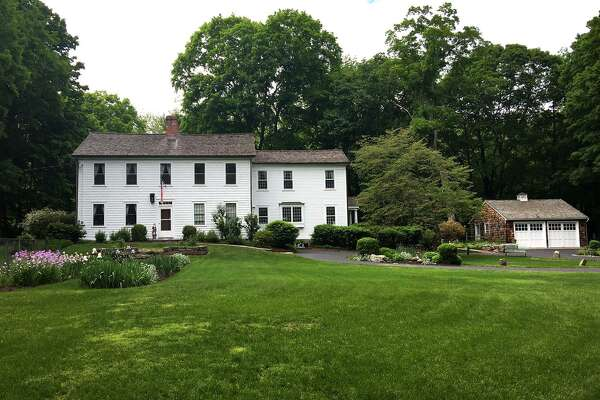 The Captain Ebenezer Hill House was built in 1765 and sits on a 2.34-acre level property at the foot of Greenfield Hill.