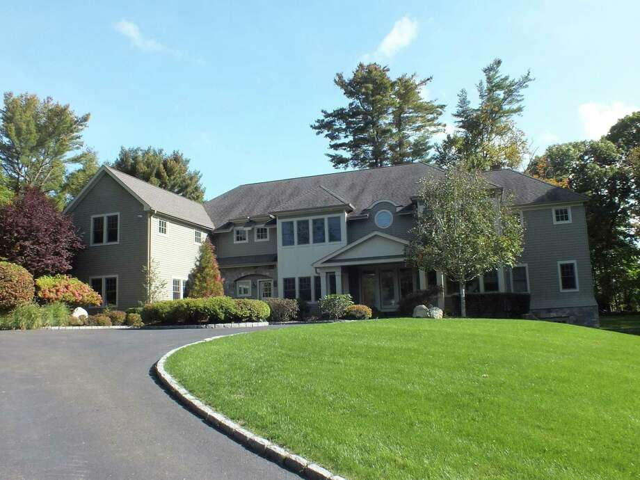 The custom-built colonial contemporary at 11 Manitou Road has 14 rooms and nearly 10,000 square feet of living space.