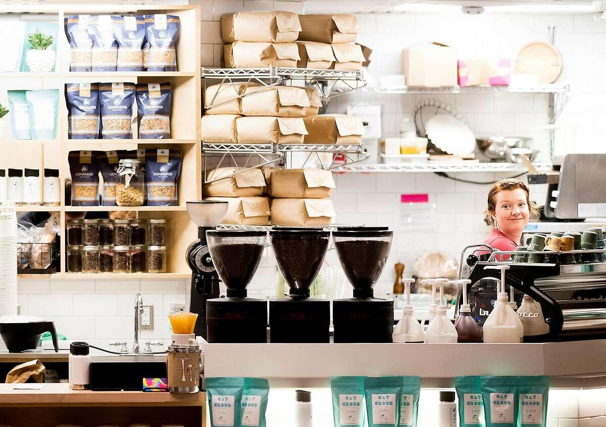 Barrista Sara Chase prepares coffee drinks at Cat. Cloud. Companion at Abbott Square Market on Sunday, Nov. 19, 2017, in Santa Cruz, Calif.