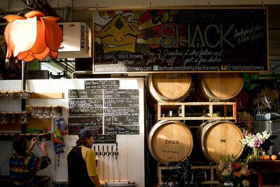 Brewer Brian McNamara pours beer at Shanty Shack Brewing in Santa Cruz, Calif., on Sunday, Nov. 19, 2017.