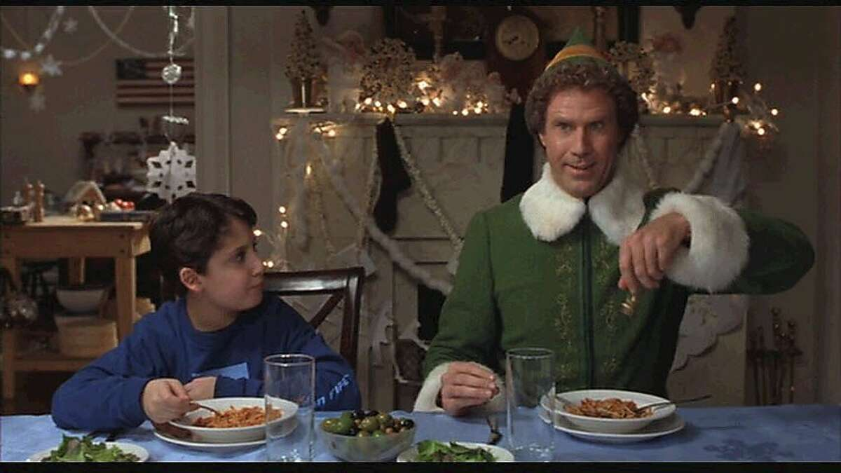 """Will Ferrell asks his new family to pass the maple syrup in """"Elf."""""""