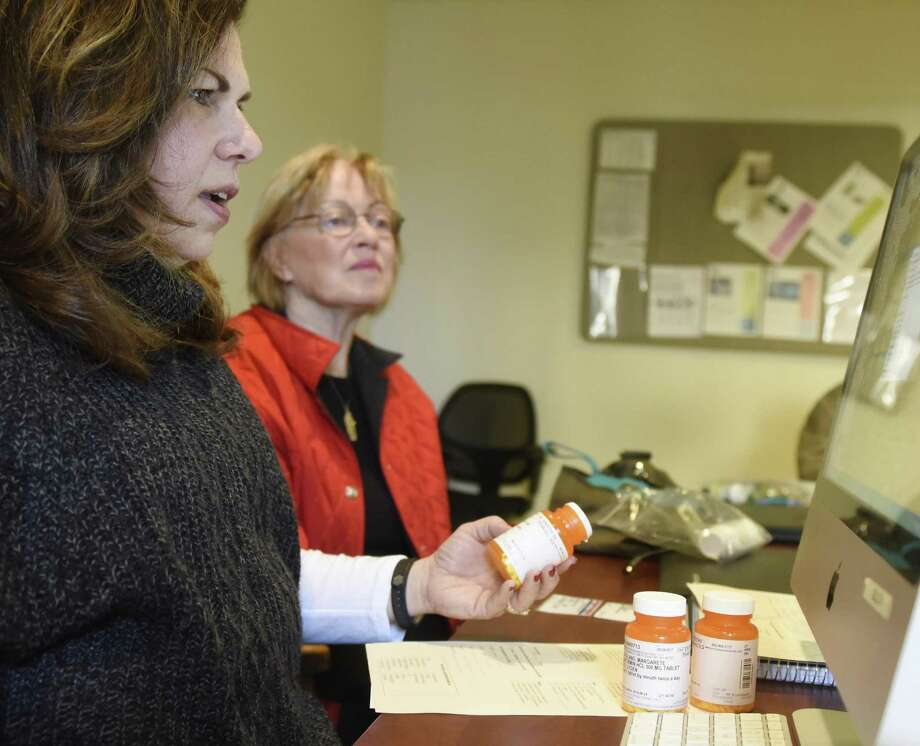 Greenwich Commission on Aging Director Lori Contadino, left, looks at Greenwich resident Margarete Catalano's prescriptions at the Medicare Part D counseling session at the Senior Center in Greenwich, Conn. Monday, Nov. 27, 2017. Presented by the Greenwich Commission on Aging, counselors helped local seniors get signed up for Medicare and find the best possible deal considering what presciptions they are on. Photo: Tyler Sizemore / Hearst Connecticut Media / Greenwich Time