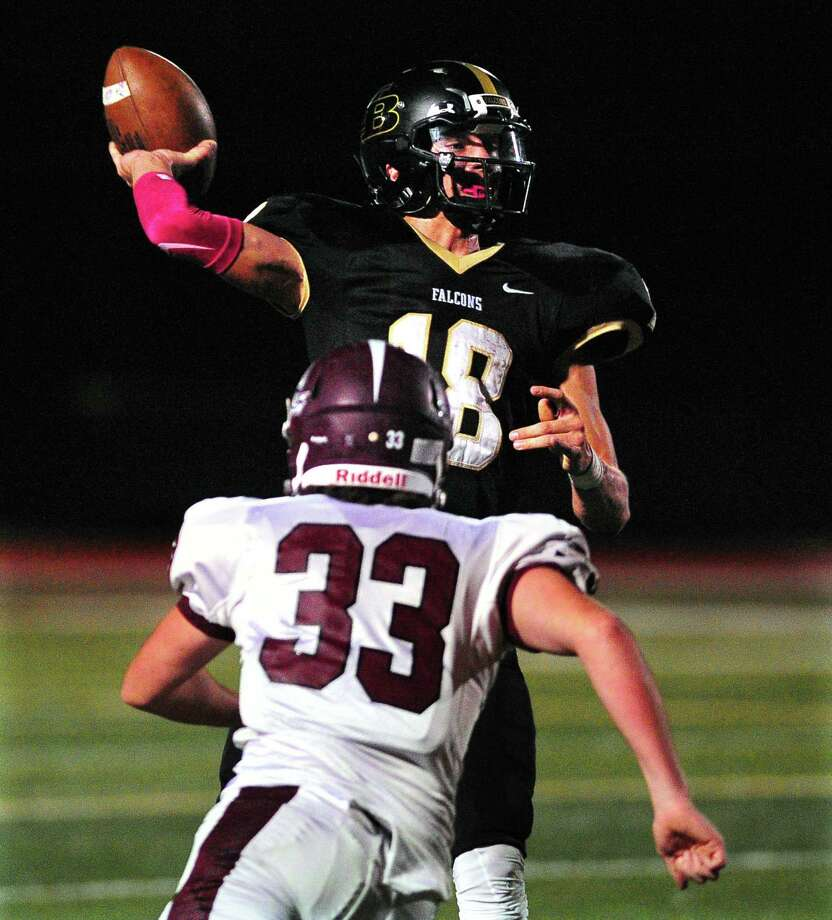 Joel Barlow QB Trevor Furrer throws a pass as East Lyme's Blake Bragaw rushes towards him during high school football action in Redding, Conn. on Friday Oct. 13, 2017. Photo: Christian Abraham / Hearst Connecticut Media / Connecticut Post