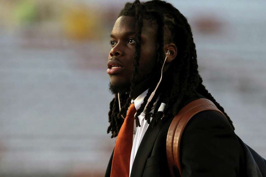 AUSTIN, TX - NOVEMBER 24:  Malik Jefferson #46 of the Texas Longhorns arrives at the stadium before the game against the Texas Tech Red Raiders at Darrell K Royal-Texas Memorial Stadium on November 24, 2017 in Austin, Texas.  (Photo by Tim Warner/Getty Images) Photo: Tim Warner, Stringer / Getty Images / 2017 Getty Images