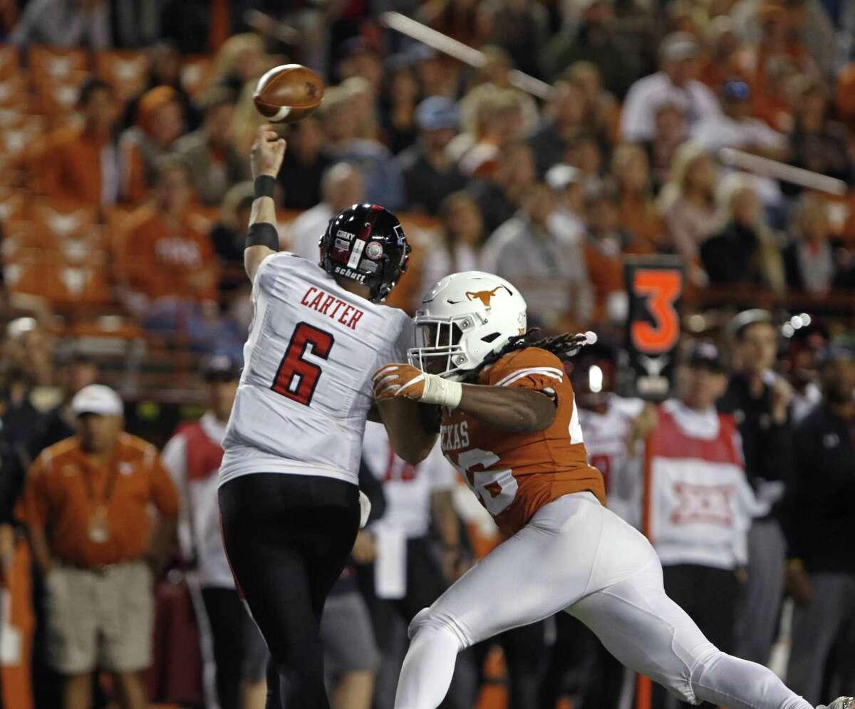 Texas linebacker Malik Jefferson, right, rushes Texas Tech quarterback McLane Carter during the second half of an NCAA college football game, Friday, Nov. 24, 2017, in Austin, Texas. Texas Tech won 27-23. (AP Photo/Michael Thomas)