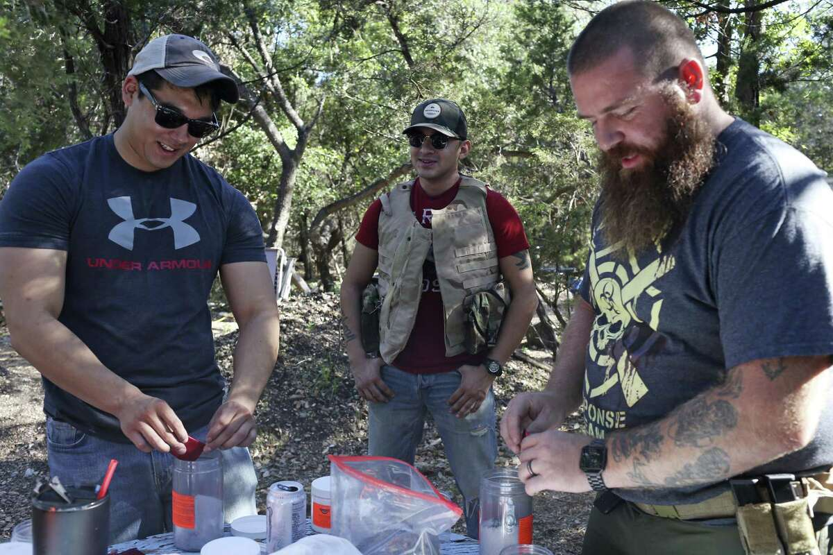 Anthony Cumpian, 24, left, and Viking Endeavor's Jeramy Rumley, 38, right, prepare Tannerite for special effects in Mico, Texas, Sunday, Oct. 8, 2017. In back is U.S. Marine veteran Justin Bernal, 26. Both Cumpian and Rumley served in the in U.S. Army.