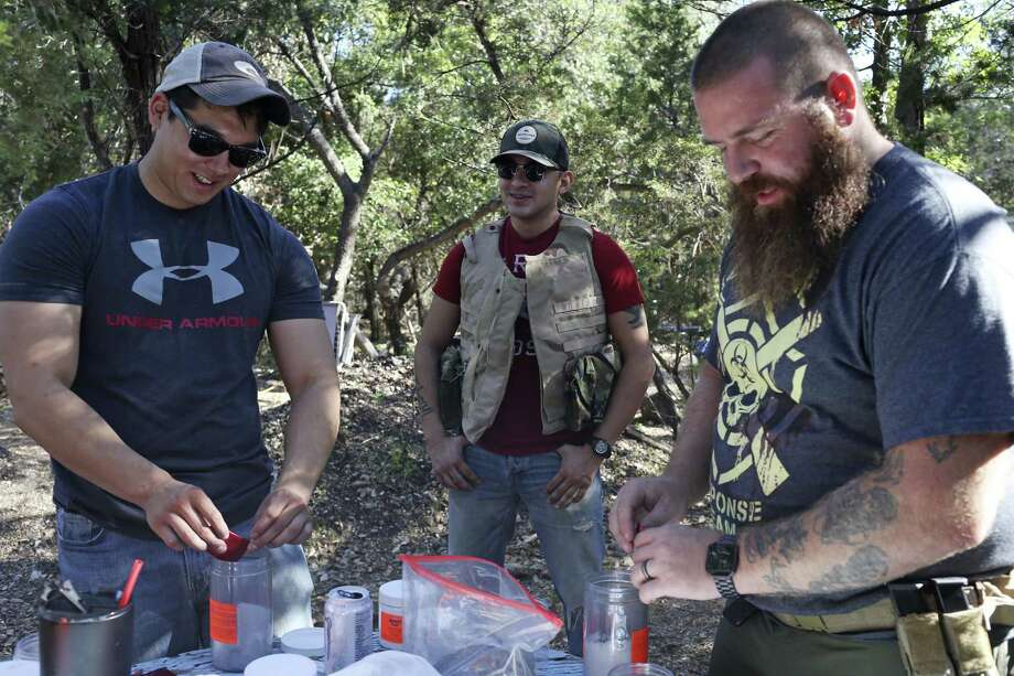 Anthony Cumpian, 24, left, and Viking Endeavor's Jeramy Rumley, 38, right, prepare Tannerite for special effects in Mico, Texas, Sunday, Oct. 8, 2017. In back is U.S. Marine veteran Justin Bernal, 26. Both Cumpian and Rumley served in the in U.S. Army. Photo: JERRY LARA / San Antonio Express-News / San Antonio Express-News