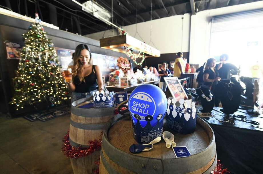 Shoppers check out local goods at the Hops and Shop Holiday Market in Miramar on Small Business Saturday, Nov. 25, 2017, in San Diego. Photo: Denis Poroy /Associated Press / AP Images
