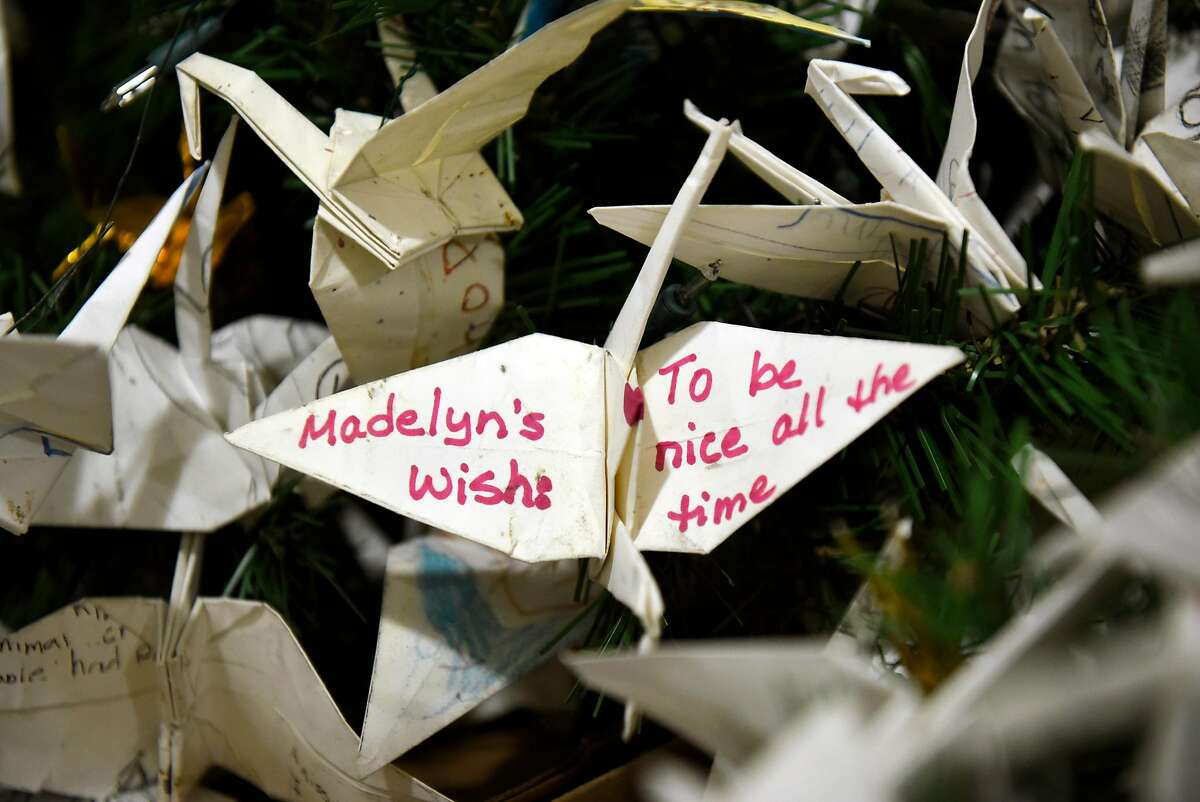 """A wish is written on a folded origami crane that will be installed on the Rainbow World Fund """"World Tree of Hope"""" at City Hall in San Francisco, CA, on Monday November 27, 2017."""