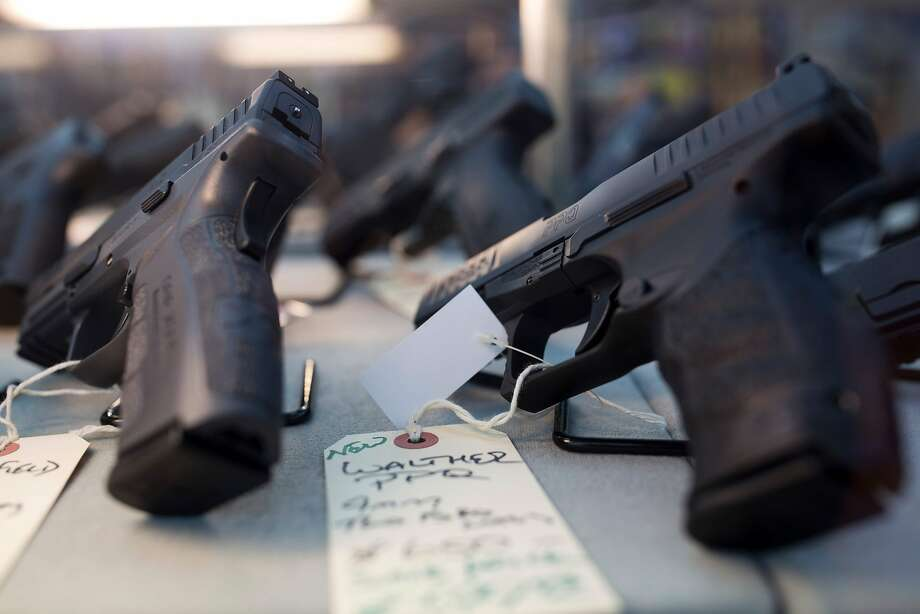 This file photo taken on November 5, 2016 shows hand guns for sale at a gun shop in Merrimack, New Hampshire.  Photo: DOMINICK REUTER, AFP/Getty Images