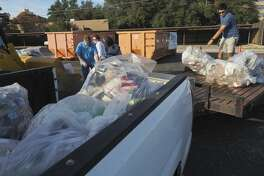 Volunteers unload pickups and trailers after being weighed 11/17/17 as non-profits compete for the most tonnage of trash collected in the annual County Trash Challenge. Tim Fischer/Reporter-Telegram