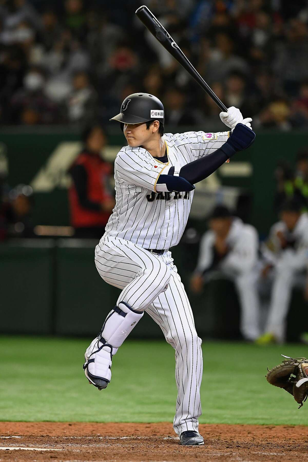 Shohei Ohtani bats during the international friendly match between Japan and Mexico at the Tokyo Dome on November 10, 2016.