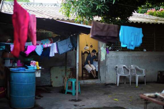 Jose Escobar, 31, video chats with his wife inside his aunt's home in La Union, El Salvador, Tuesday, Sept. 26, 2017. ( Marie D. De Jesus / Houston Chronicle )