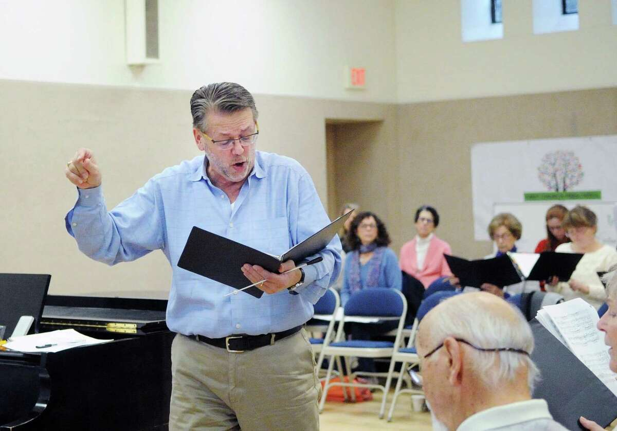 Greenwich Choral Society Music Director Paul Mueller leads the society's rehearsal at the First Congregational Church in Old Greenwich, Conn., Saturday morning, Nov. 18, 2017. The Greenwich Choral Society will be presenting their