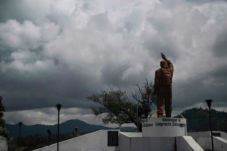 "A statue facing north honors the migrants from Salcaja who establish themselves away from Guatemala and send ""remesas"" or remittances back to their families in Salcaja.   Tuesday, Oct. 3, 2017, in Guatemala. ( Marie D. De Jesus / Houston Chronicle )"