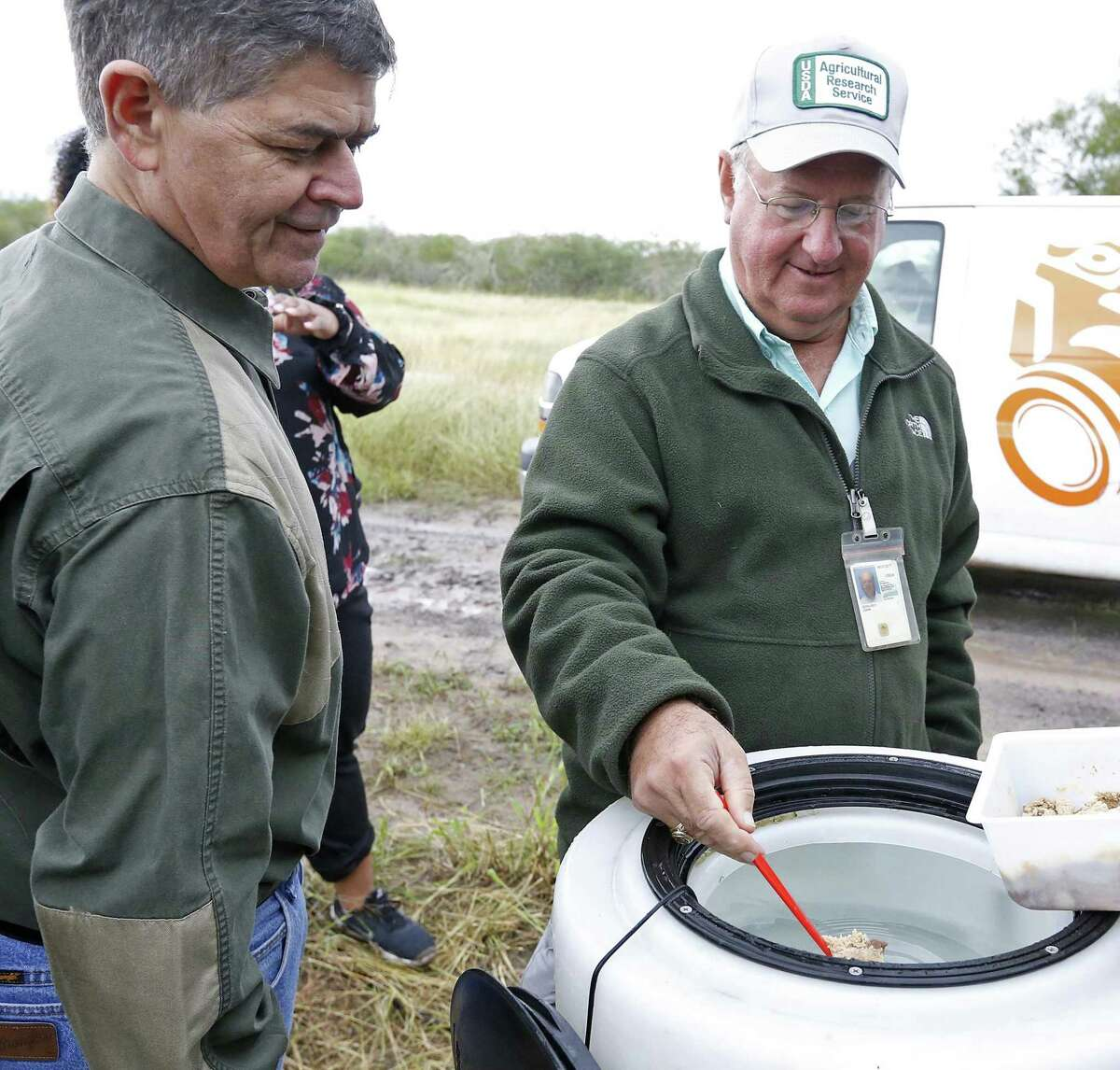 U.S. Department of Agriculture research entomologist John A. Goolsby, right, shows U.S. Rep. Filemon Vela, D-Brownsville, nematodes for use with a Nilgai Sprayer at Russell Ranch on Nov. 20, 2017 in Rio Hondo. Goolsby is using the nematodes to try to eradicate cattle fever ticks in South Texas.
