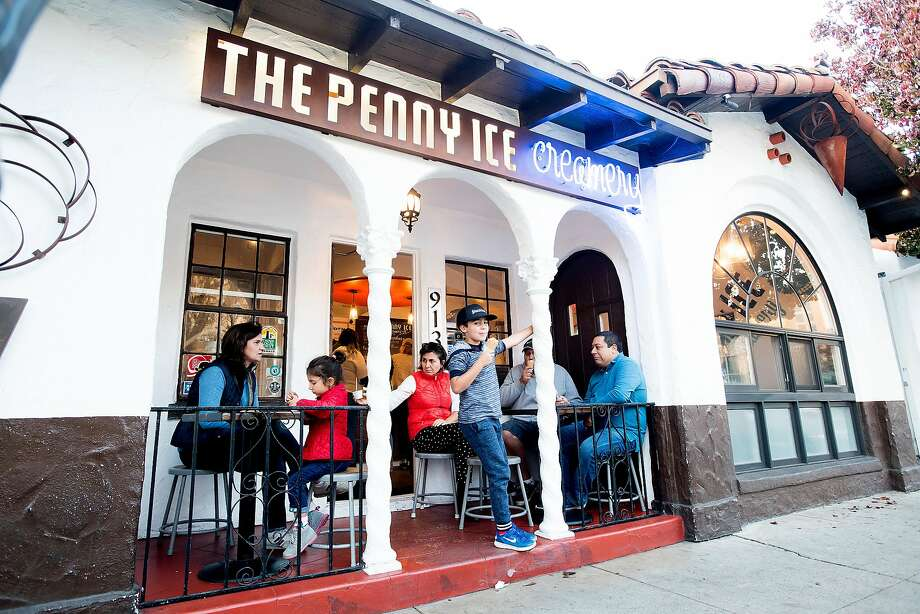 Patrons eat outside the Penny Ice Creamery, where the ice cream is made completely from scratch, in Santa Cruz. Photo: Noah Berger, Special To The Chronicle