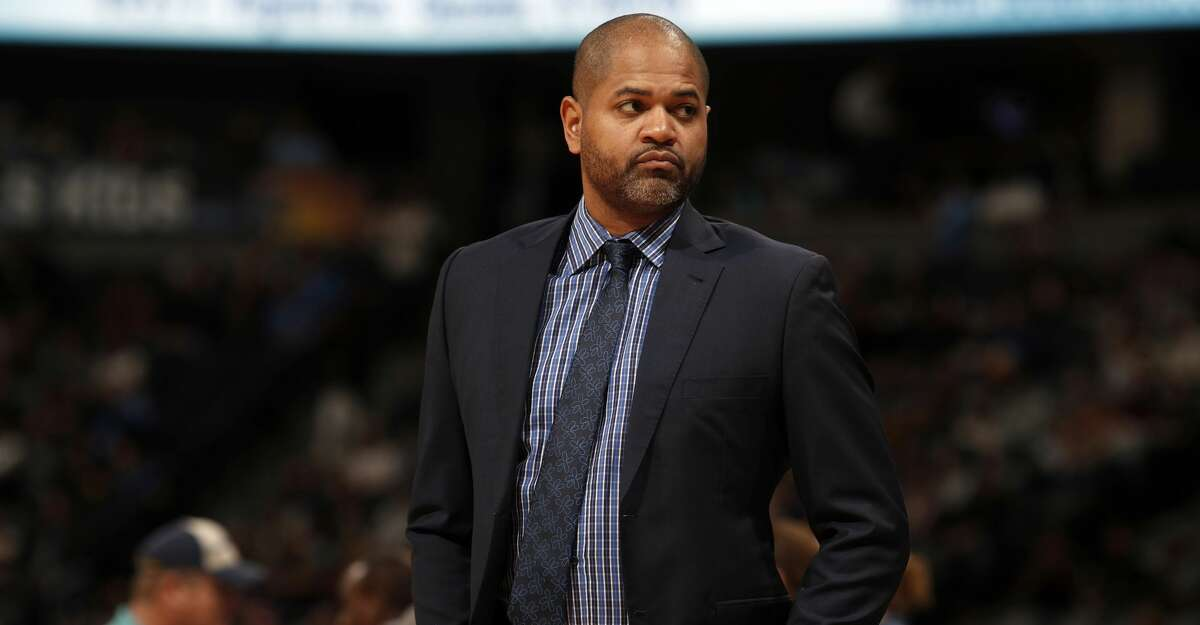 FILE - In this Nov. 24, 2017, file photo, Memphis Grizzlies associate head coach J.B. Bickerstaff looks on during the first half of an NBA basketball game in Denver. The Grizzlies have fired coach David Fizdale, with the team at 7-12. General manager Chris Wallace announced the move Monday, Nov. 27, 2017. Bickerstaff has been named interim head coach. (AP Photo/David Zalubowski, File)