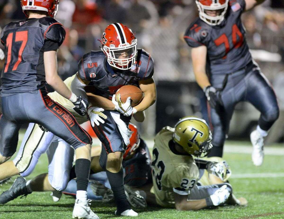 New Canaan Owen Shin drives up the middle for a first down against Trumbull in a FCIAC varsity football game in New Canaan, Connecticut on Friday, Sept. 22, 2017. New Canaan defeated Trumbull 61-14.