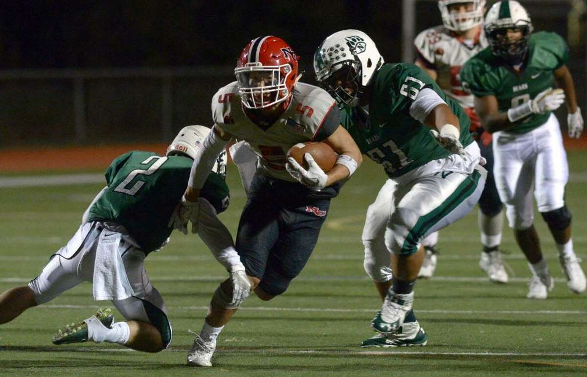 5 for New Canaan, Owen Shin, heads for the goal line as the Norwalk High School Bears football team takes on the New Canaan Rams Friday, November 3, 2017, in Norwalk, Conn.