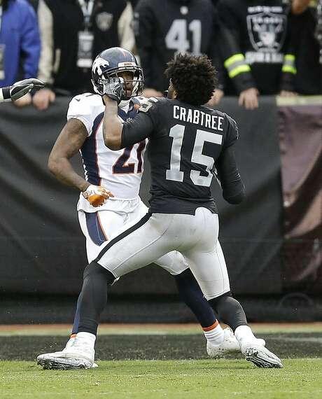 Denver Broncos cornerback Aqib Talib (21) fights Oakland Raiders wide receiver Michael Crabtree (15) during the first half of an NFL football game in Oakland, Calif., Sunday, Nov. 26, 2017. (AP Photo/Ben Margot) Photo: Ben Margot, Associated Press