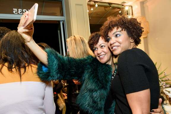 Cara Kelly and Sherri McMullen (right) at the Nov. 15 cocktail party celebrating the boutique's 10-year anniversary.
