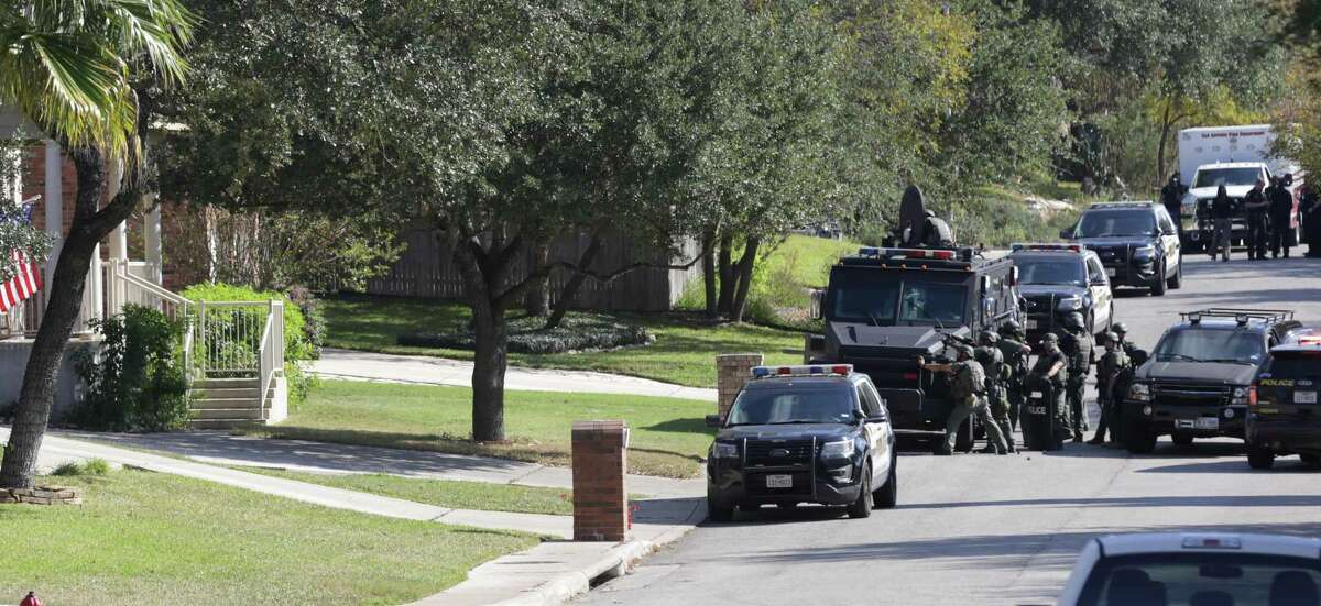 SWAT team fires tear gas in a window of the house at 13827 Possum Tree where two shots were fired, on Monday , Nov.27, 2017.