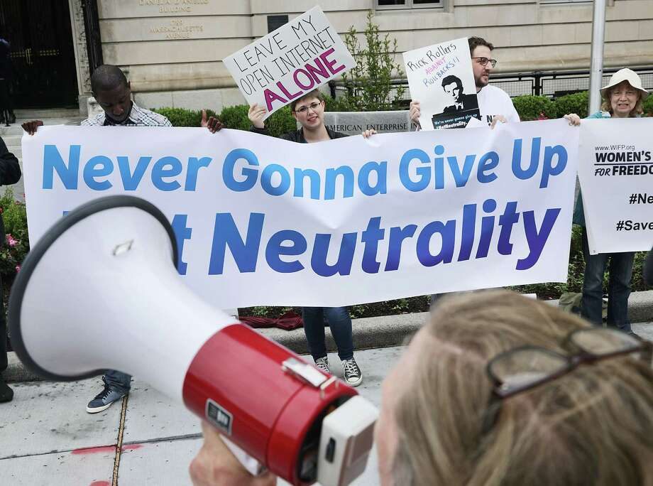Proponents of net neutrality protest in May against Federal Communication Commission Chairman Ajit Pai in Washington.  Photo: Chip Somodevilla, Staff / 2017 Getty Images