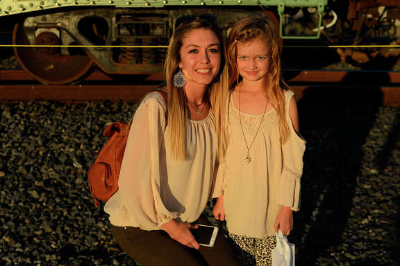 Kimberly and Skylar Everitt at the Kansas City Southern Holiday Express stop in Beaumont on Monday evening. The Christmas rail cars are traveling through six states this year, with KCS donating money to the local Salvation Army in each of the 22 cities they'll visit.  Photo taken Monday 11/27/17 Ryan Pelham/The Enterprise