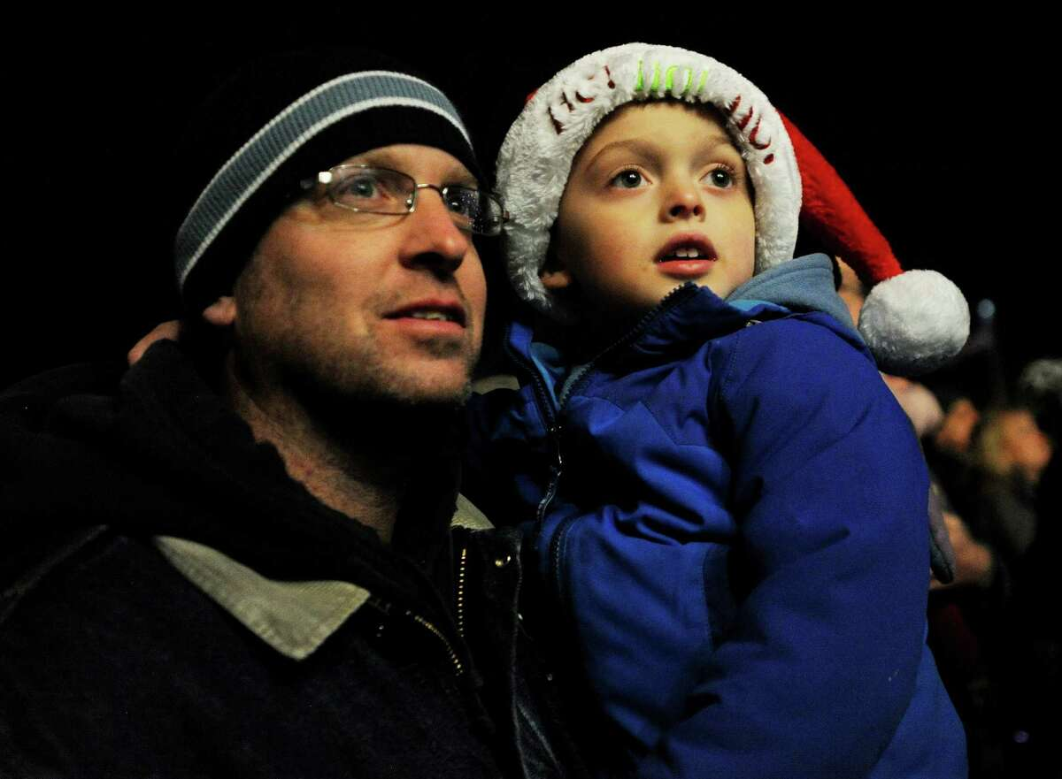 Phil Higgins and son Cameron, 4, of Stratford, attend the town's Holiday Lighting Festival in front of Town Hall in Stratford, Conn. on Monday, November 27, 2017.