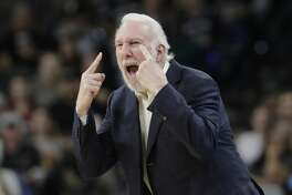 San Antonio Spurs head coach Gregg Popovich argues a call with an official during the first half of an NBA basketball game against the Dallas Mavericks, Monday, Nov. 27, 2017, in San Antonio. Popovich was ejected from the game. (AP Photo/Eric Gay)