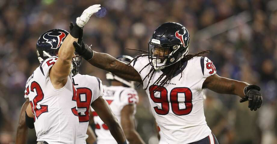 Houston Texans outside linebacker Jadeveon Clowney (90) celebrates his sack on Baltimore Ravens quarterback Joe Flacco (5) with linebacker Brian Peters (52) during the first quarter of an NFL football game at M & T Bank Stadium on Monday, Nov. 27, 2017, in Baltimore. ( Brett Coomer / Houston Chronicle ) Photo: Brett Coomer/Houston Chronicle
