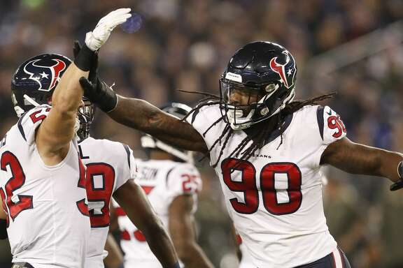 Houston Texans outside linebacker Jadeveon Clowney (90) celebrates his sack on Baltimore Ravens quarterback Joe Flacco (5) with linebacker Brian Peters (52) during the first quarter of an NFL football game at M & T Bank Stadium on Monday, Nov. 27, 2017, in Baltimore. ( Brett Coomer / Houston Chronicle )