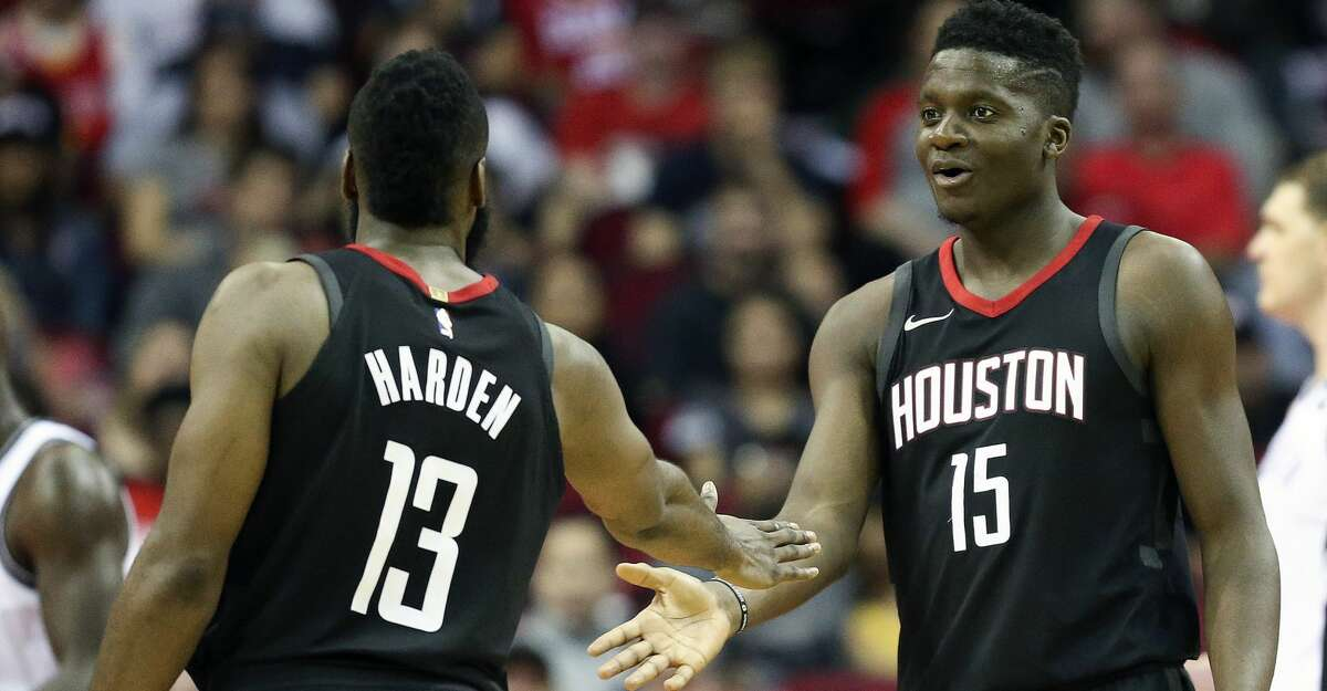 Houston Rockets center Clint Capela (15) shakes guard James Harden's hand after drawing a foul during the second half of an NBA basketball game against the Brooklyn Nets, Monday, Nov. 27, 2017, in Houston. Houston won the game 117-103. (AP Photo/Eric Christian Smith)