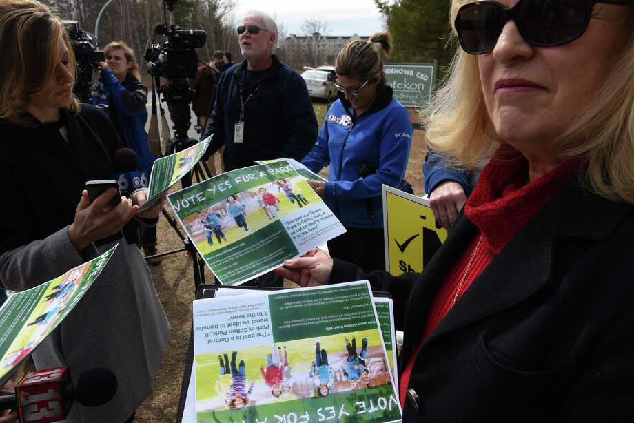 Susan Burton, vice president of the Friends of Clifton Park Open Space, on Monday, April 3, 2017, during a press conference in Clifton Park, N.Y. Friends of Clifton Park Open Space are making a last-minute push to ensure the 37-acres of wooden land in the center of town will become a park. Burton, vice president of the group, said volunteers stood out in front of the Hannaford and Market 32 near Northway Exit 9 in shifts on Friday, Saturday and Sunday to distribute flyers reminding people to vote yes on Tuesday at Gowana Middle School. Photo: Will Waldron / 20040126A