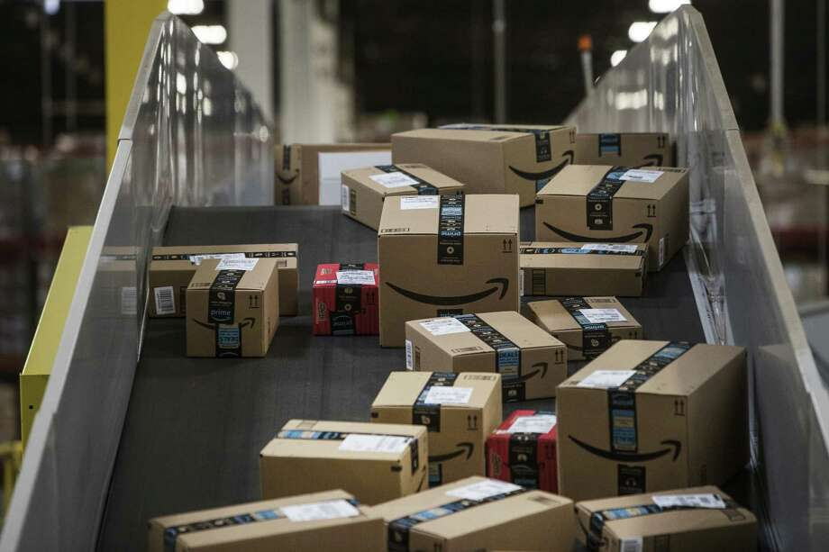 Packages move along a conveyer belt at the Amazon.com fulfillment center in Robbinsville, N.J. The online shift was noticeable before Cyber Monday. Photo: Victor J. Blue / © 2017 Bloomberg Finance LP