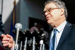 US Senator Al Franken, Democrat of Minnesota, speaks outside his office on Capitol Hill in Washington, DC, on November 27, 2017. Franken, under scrutiny over multiple allegations of misconduct, offered a fresh apology as he arrived on Capitol Hill, while veteran Democrat John Conyers has stepped down from a leadership position over similar claims. / AFP PHOTO / JIM WATSONJIM WATSON/AFP/Getty Images ORG XMIT: US Senato