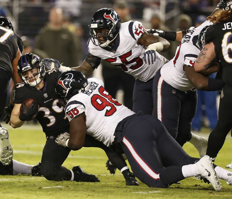 Baltimore Ravens running back Danny Woodhead (39) is brought down by Houston Texans defensive end D.J. Reader (98) after gaining five yards during the third quarter of an NFL football game at M & T Bank Stadium on Monday, Nov. 27, 2017, in Baltimore. ( Brett Coomer / Houston Chronicle ) Photo: Brett Coomer/Houston Chronicle