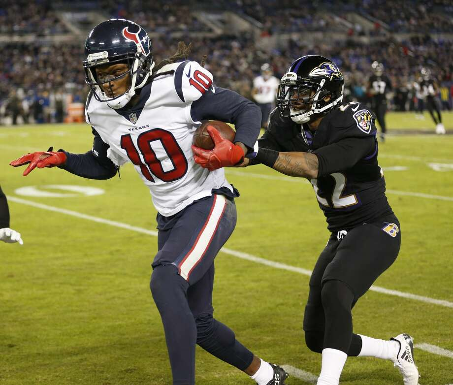 Houston Texans wide receiver DeAndre Hopkins (10) catches a long pass against Baltimore Ravens cornerback Jimmy Smith (22) during the fourth quarter of an NFL football game at M & T Bank Stadium on Monday, Nov. 27, 2017, in Baltimore. ( Brett Coomer / Houston Chronicle ) Photo: Brett Coomer/Houston Chronicle