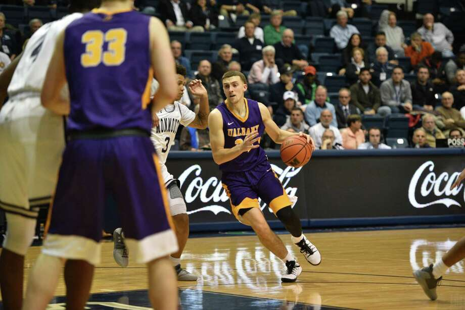 UAlbany's Joe Cremo carries the ball against Monmouth University in West Long Branch, N.J., on Monday, November 27, 2017. (Karlee Sell / Monmouth University)