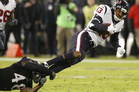 Houston Texans wide receiver Braxton Miller (13) catches a 14-yard pass against Baltimore Ravens inside linebacker Patrick Onwuasor (48) during the third quarter of an NFL football game at M & T Bank Stadium on Monday, Nov. 27, 2017, in Baltimore. ( Brett Coomer / Houston Chronicle )