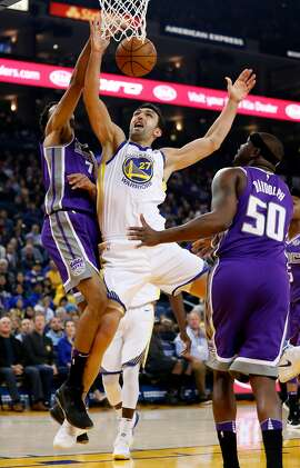 Golden State Warriors' Zaza Pachulia loses the ball against Sacramento Kings' Skal Labissiere and Zach Randolph in 1st quarter during NBA game at Oracle Arena in Oakland, Calif., on Monday, November 27, 2017.