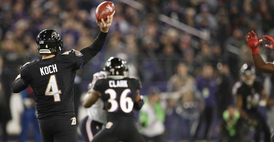 Baltimore Ravens punter Sam Koch (4) passes the ball on a fake punt during the second quarter of an NFL football game at M & T Bank Stadium on Monday, Nov. 27, 2017, in Baltimore. ( Brett Coomer / Houston Chronicle ) Photo: Brett Coomer/Houston Chronicle